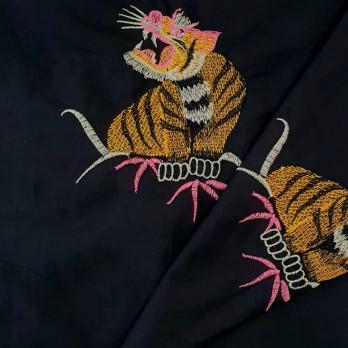 Tricoline B. Tiger